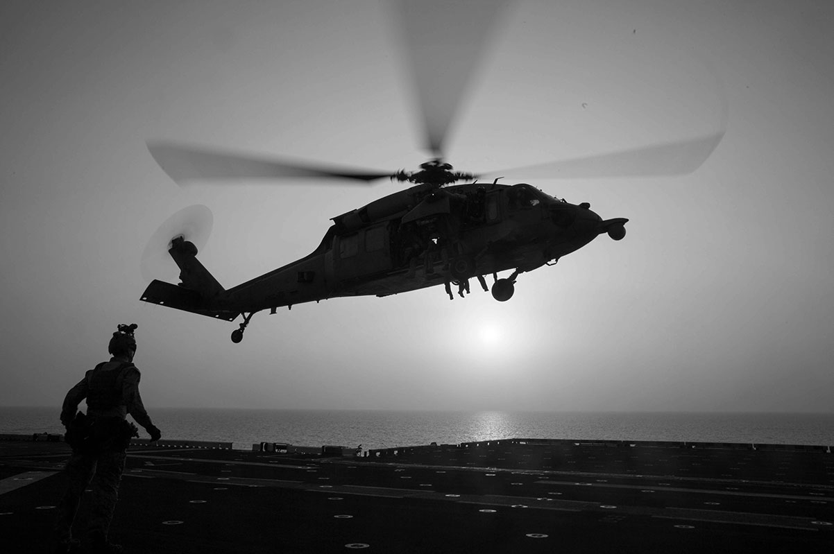 Helicopter lifting off from an aircraft carrier